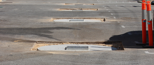A line of newly installed soakwell covers